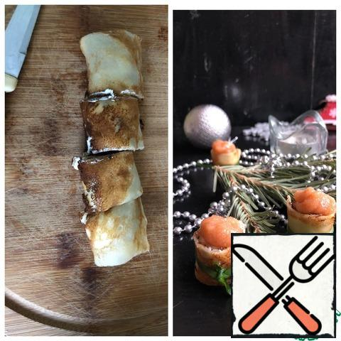 """Cut each roll into portioned pieces, tie each """"washer"""" in the middle with green onions."""