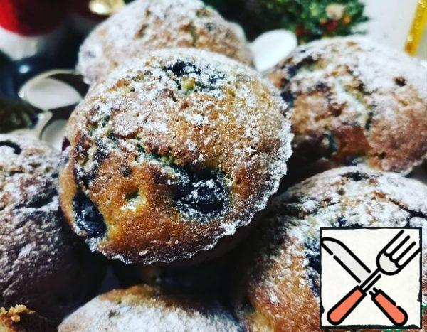 When the muffins are cool, sprinkle them with powdered sugar and serve.
