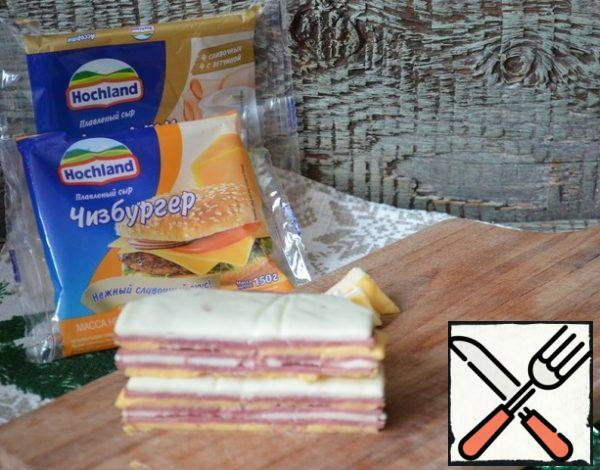 Fold the cheese and ham into a pile, trim and cut into 4 pieces.