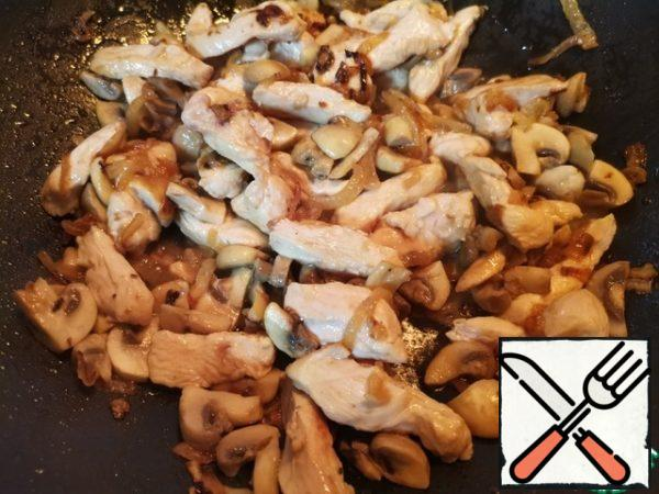 Add the chicken with mushrooms to the onion and fry stirring for 3-4 minutes.