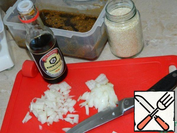 Mix soy sauce, sugar, chopped onion, garlic, ginger, sesame seeds and vegetable oil.