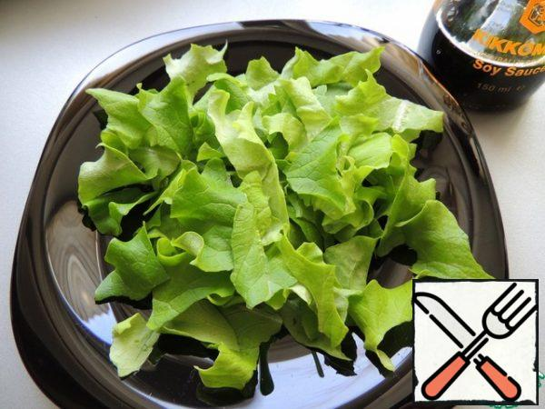 Lettuce leaves are torn by hand.