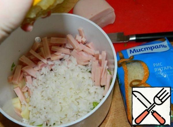 Add the rice. Squeeze a little lemon juice.