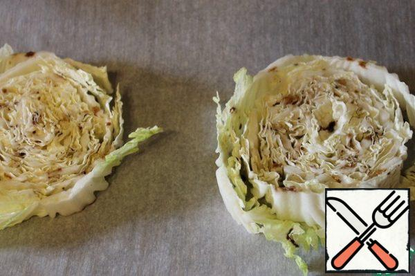 Put the cabbage on a baking sheet covered with parchment, pour the dressing on top.