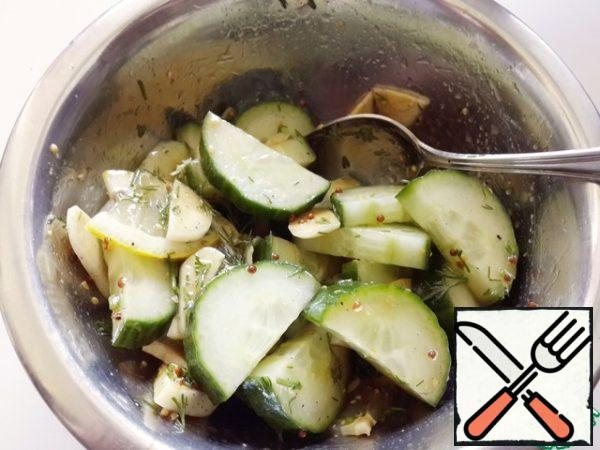 Pour the dressing over the cucumbers and lemon, and mix.