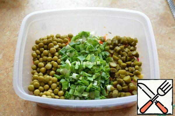 Add the peas, chopped onion, and chopped gherkins; Stir well;