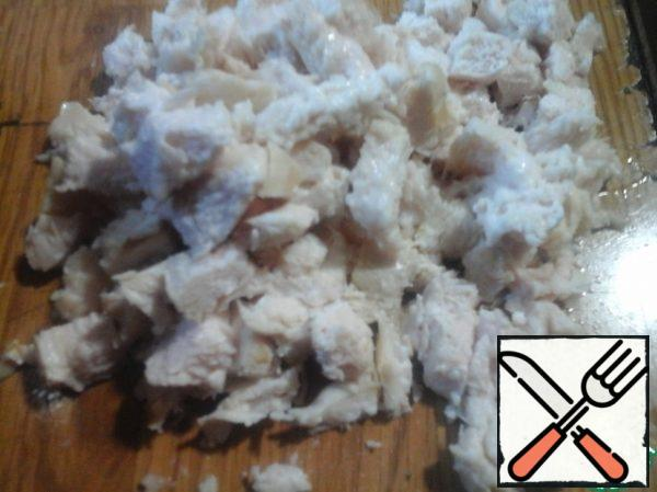 Cut the boiled chicken breast into cubes.
