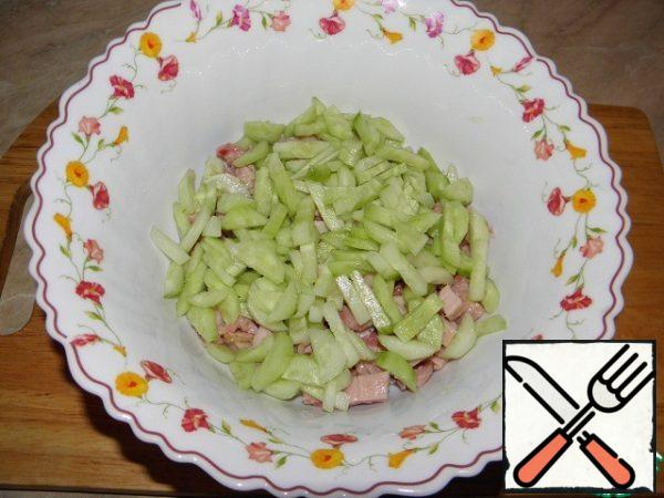 Cucumbers peel and cut into strips, add to the chicken.