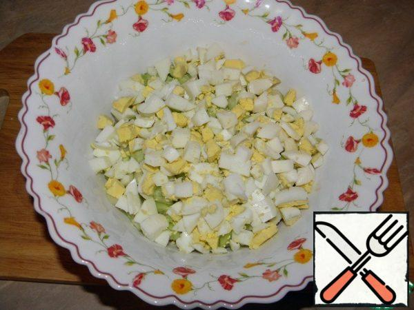 Eggs (pre-cook) cut into cubes, add to the chicken and cucumbers.