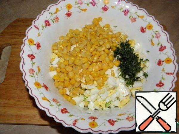 Then add the chopped dill and corn (drain the liquid).