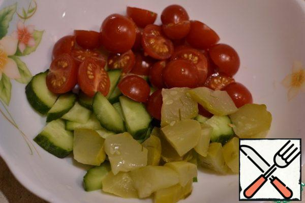 Cherry cut in half, mix with cucumbers.