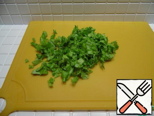 Chop the salad.