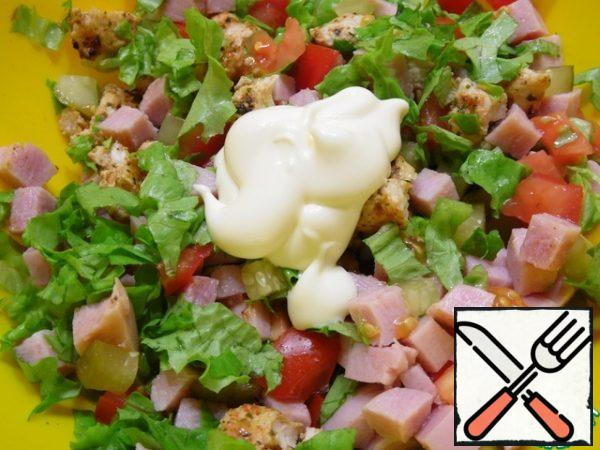 Mix all the prepared products, add salt, and season with mayonnaise.