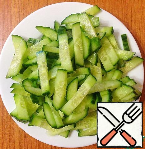 Cucumber is also cut into cubes.