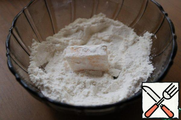 Cut the cheese into pieces and pan in flour.