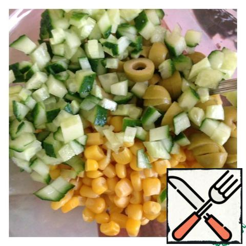 Cucumber cut into small cubes, olives in circles. Add the corn.