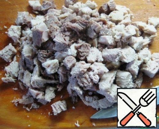 Boil the meat and cut it into small cubes.
