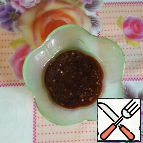 For dressing, mix soy sauce, vegetable oil, lemon juice and garlic, add black pepper to taste.