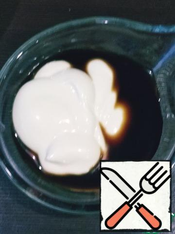 Mix soy sauce and mayonnaise, add salt and pepper to taste.