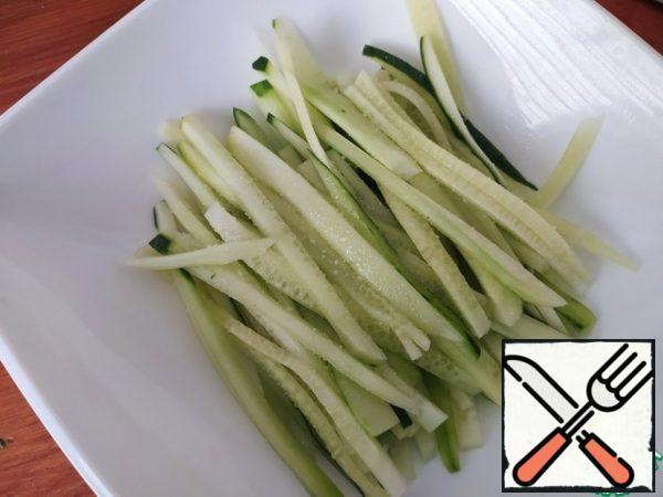 Cucumbers cut into thin long strips.
