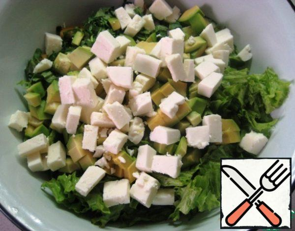 Also, cut the Adyghe cheese into small pieces and add it to the salad.