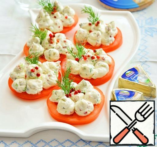 The cheese mass can be made in advance. It is perfectly stored in the refrigerator for 3-4 days. And as soon as the guests descended-cut the tomato and put the cheese mass on it. It helps out a lot during the holidays.