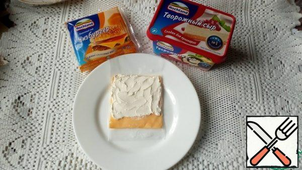 Spread the remaining curd cheese on a teaspoon with the top on the slices of melted cheese.