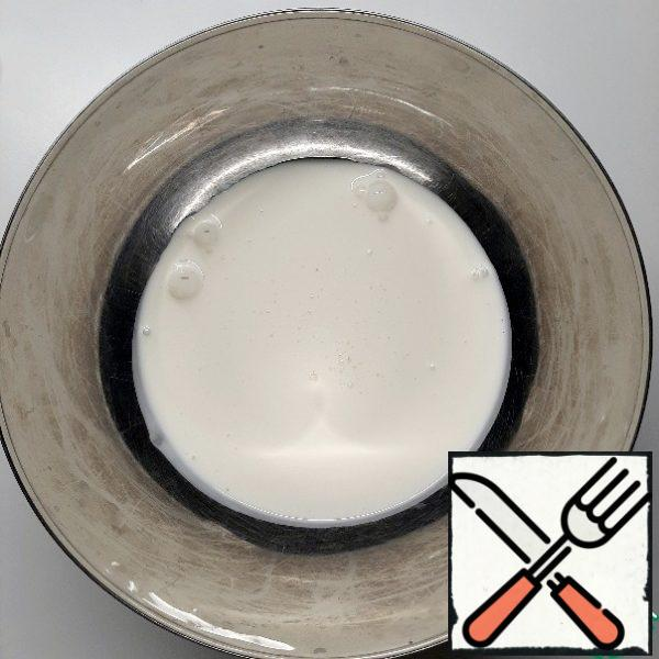 Pour the cream into a suitable bowl for a water bath.