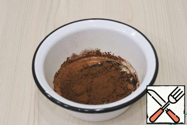 Next, add 15 gr to the milk-oil base. cocoa powder. Stir the mixture with a culinary spatula.