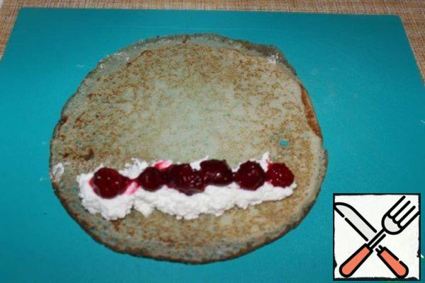 Put cottage cheese with powdered sugar on a pancake, and cherries on top.