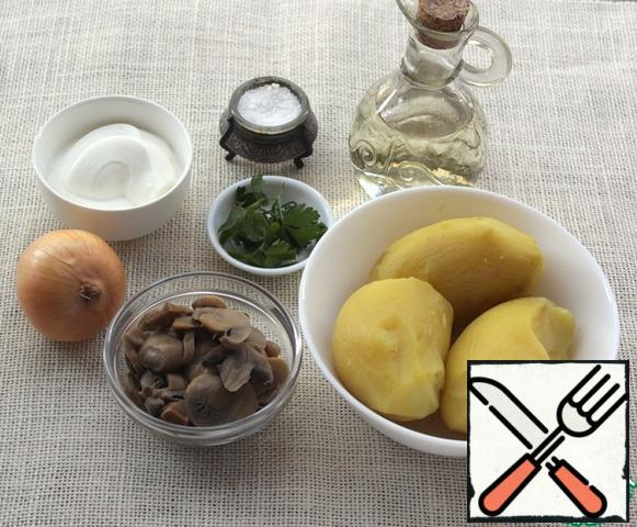Boiled potatoes in a uniform, canned mushrooms, sour cream, onions, these are the main ingredients from which you can prepare a delicious lunch or dinner.