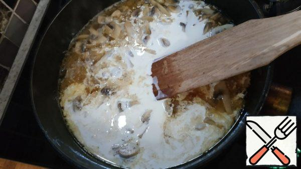 Pour in the wine and cream. Add salt and pepper and simmer over medium heat for 7 minutes.