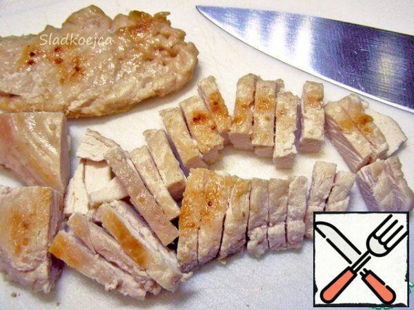 Boil or fry the chicken fillet.
