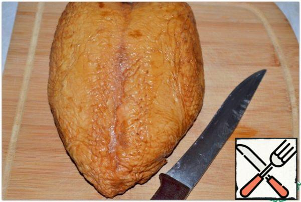 Smoked chicken breast is cleaned from the skin and bones..