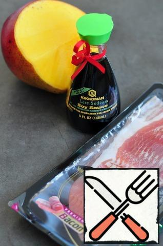Peel the mango and wrap it in a strip of bacon.