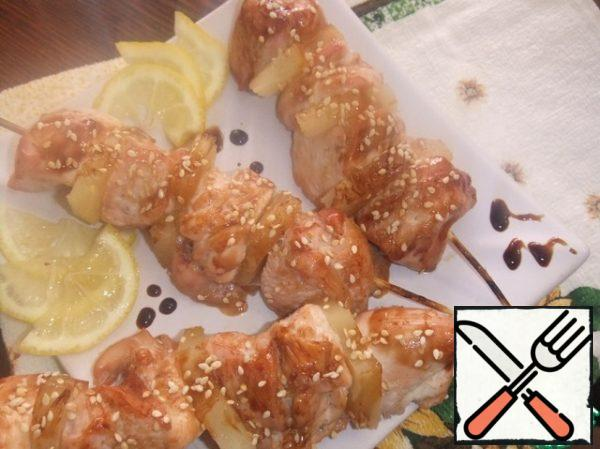 Ready-made shish kebabs hot sprinkle with sesame seeds.