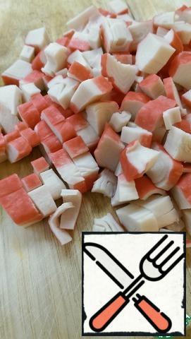 Cut the crab sticks into cubes.