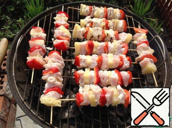 Bake on a barbecue grill until tender, 5 minutes on each side.