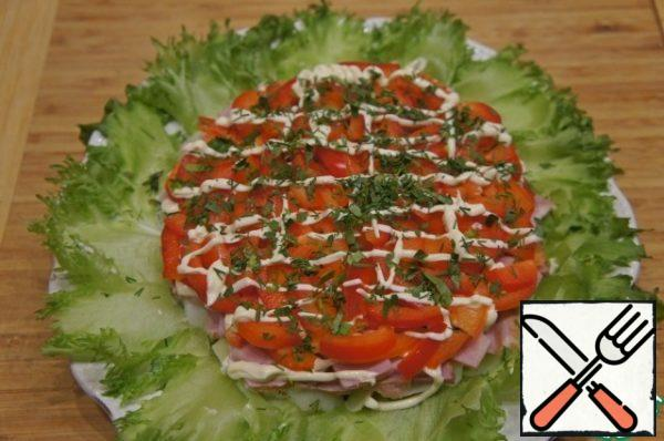 Then put the bell pepper, cut into strips, apply a mesh of mayonnaise and sprinkle with finely chopped herbs.