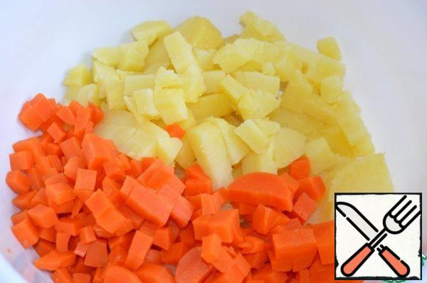 Cut potatoes and carrots into small cubes.