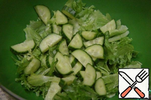 Add the cucumber, cut into half rings.