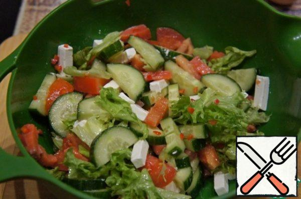 Pour over the salad and mix very gently.