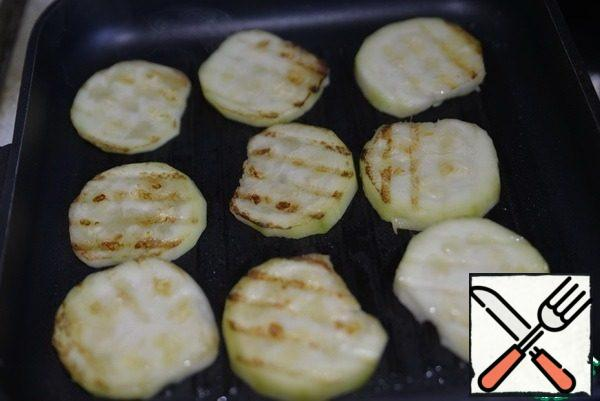 Brush with olive oil and fry on both sides in a grill pan.