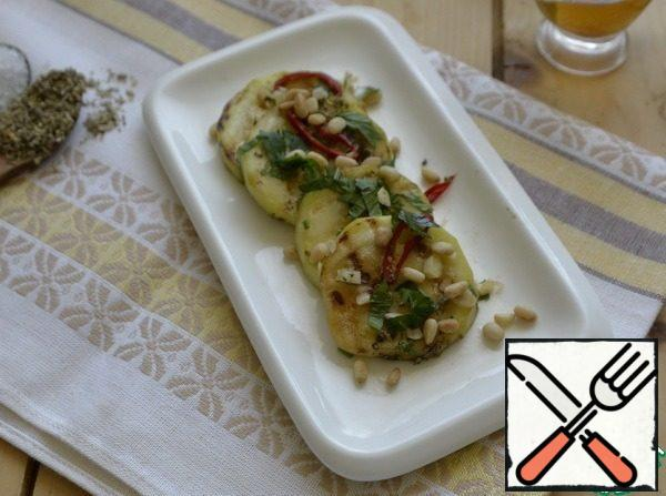 Hot zucchini sprinkle with coarse sea salt, sprinkle with balsamic vinegar, sprinkle with Provencal herbs. Put the chopped garlic, hot pepper and celery. Gently mix, cover with a lid or bag, put in the refrigerator to cool.Serve the appetizer chilled, when serving sprinkle with roasted pine nuts.