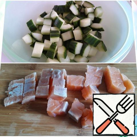 Salmon is cut into small cubes, cucumber is also finely chopped.