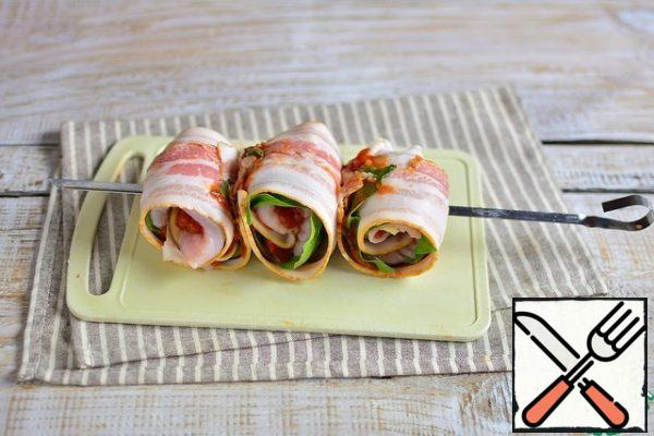 Similarly, we form and string 2 more rolls on the skewer.