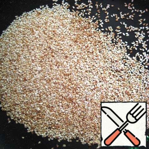 Heat the sesame seeds in a dry pan until golden brown, remove from the heat, and let cool.