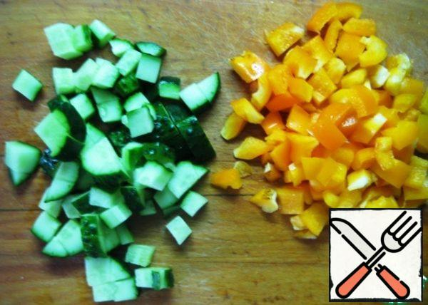 Cucumber and bell pepper cut into small pieces.