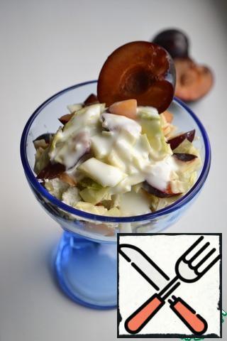 Arrange the salad in serving salad bowls, season with kefir.