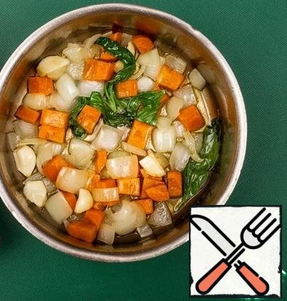 Chop the onion and carrot coarsely, fry with garlic and basil over medium heat until soft.